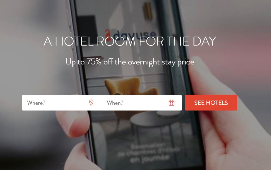 Person Holding Mobile Phone on Dayuse.com website